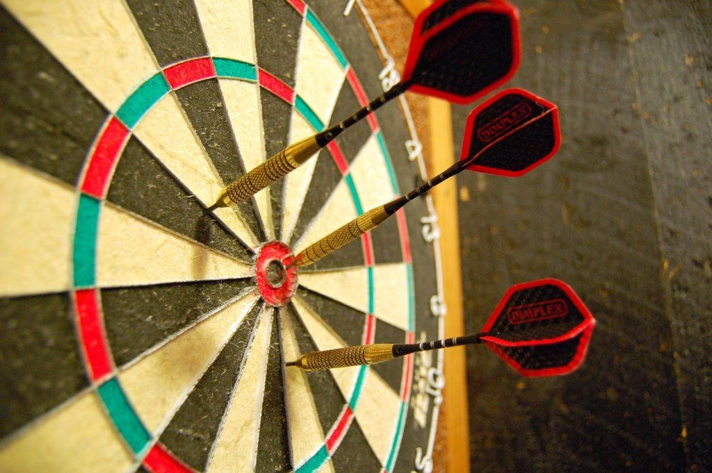 3 darts on a dart board