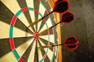 3 darts on a dart board